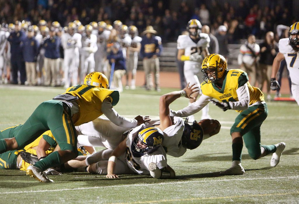 Gabriel Baker tries to stretch across the end zone during the Miners' first touchdown drive of the game against the Vanden Vikings. The miners scored two touchdowns during the game.