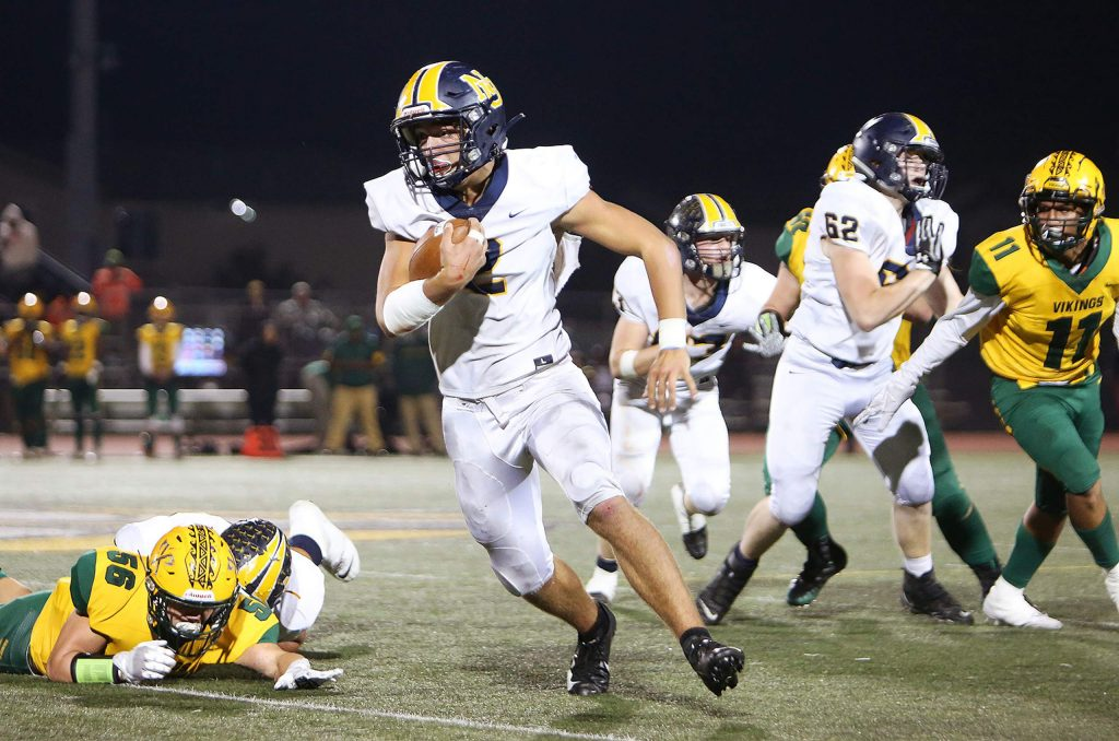 Quarterback Gabriel Baker (2) carries the ball on the option during the Miners' loss to the Vikings.
