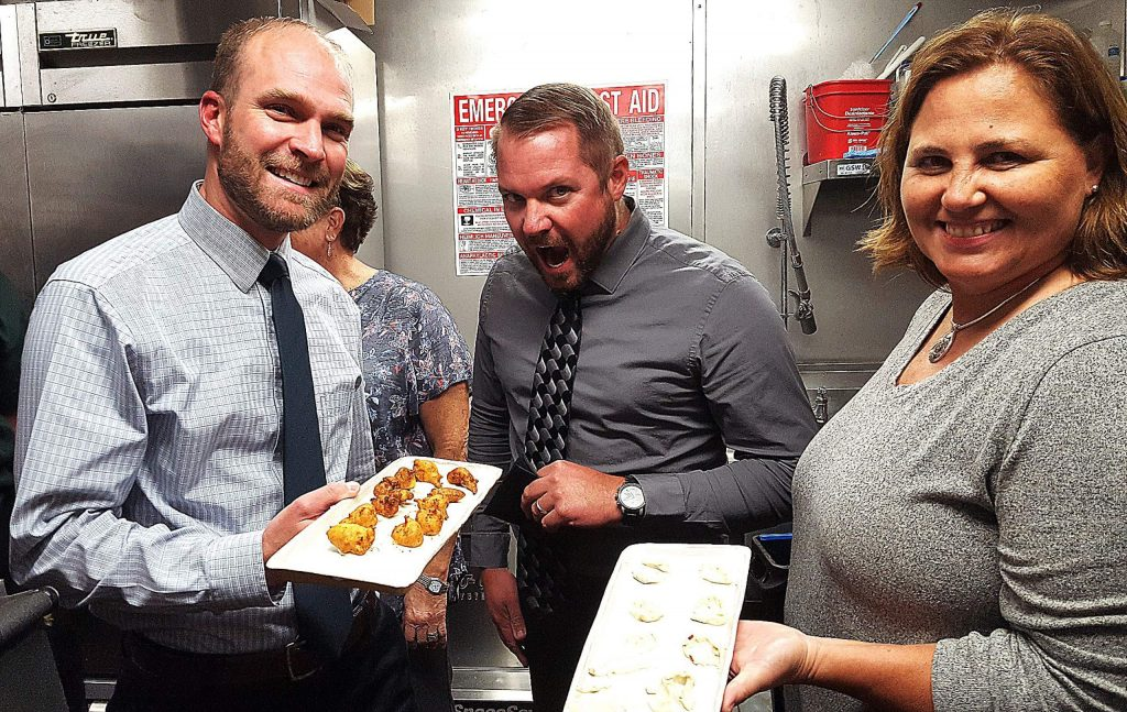 Grass Valley Police Chief Alex Gammelgard, from left, Nevada City Police Chief Chad Ellis and Nevada County Sheriff Shannan Moon served appetizers to the crowd during the Firefighters Thanksgiving benefit.