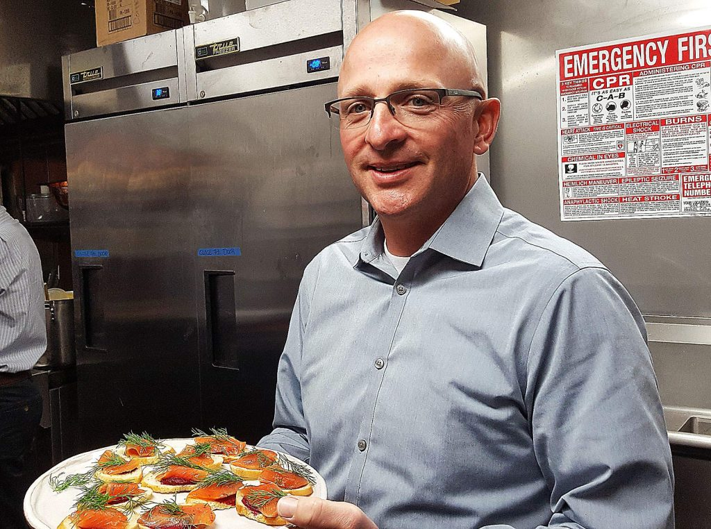 California Highway Patrol Commander George Steffenson served up appetizers to the crowd at Golden Era Monday.