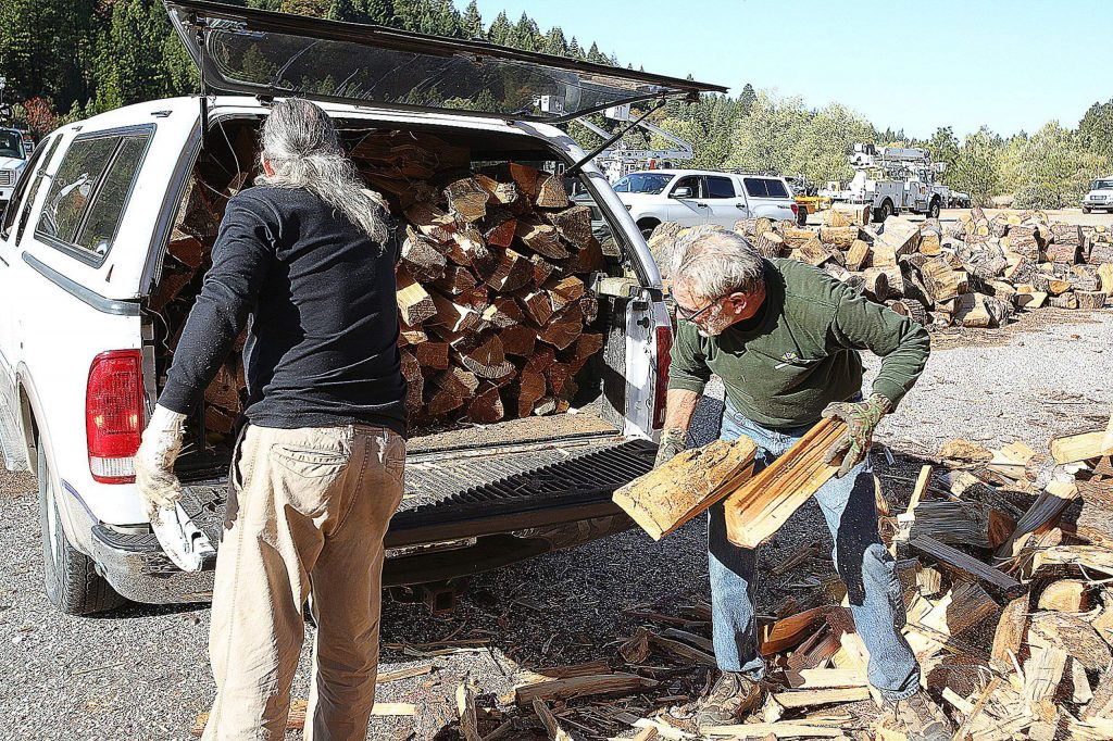 The Senior Firewood Program provides firewood to low-income seniors who need help staying warm in the winter. On Saturday, volunteers helped pack trucks, cars, camper shells, and trailers full of wood to be taken home.