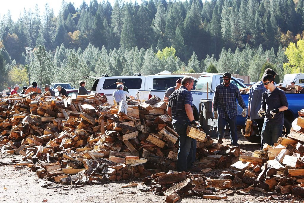 Dozens of volunteers make quick work to load up senior firewood during the final of three annually scheduled firewood distribution days, which include the first and last Saturdays of October, and the first Saturday of November.