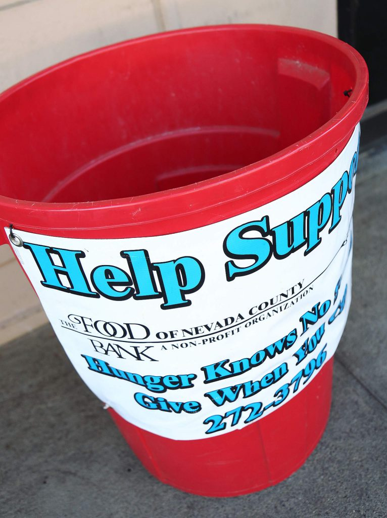 A bucket for nonperishable food items sat outside waiting to be filled to help those who use the Food Bank of Nevada County.