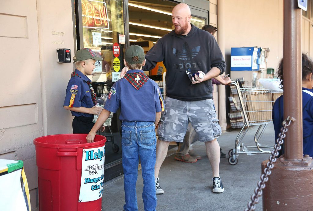 Many generous people donated to the Food Bank of Nevada County Saturday at SPD in Nevada City with the help of Cub Scout Pack 23.