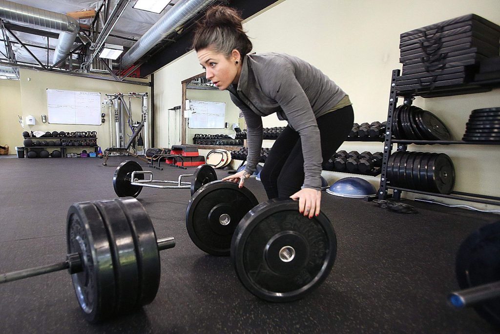 Best Life Fitness Academy trainer Jen Ayala feels at home on the gym floor located off of Crown Point Circle.