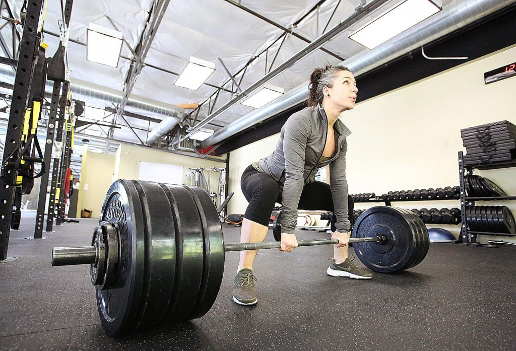 Local fitness trainer Jen Ayala set a new weight lifting world record for her weight class, lifting 340 lbs.