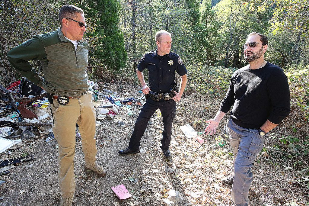Grass Valley Police Department's Sgt. Brian Blakemore, Chief Alex Gammelgard, and Hospitality House Home Team's Joe Naake, explain their efforts to help get homeless out of fire prone areas, such as the Loma Rica Ranch, and into services, in this Nov. 4 file photo. The Dorsey Fire, which burned about 30 acres of the Loma Rica Ranch on  Oct. 27, has revived fear of homeless individuals after it was determined that a man living in the bush was at fault.