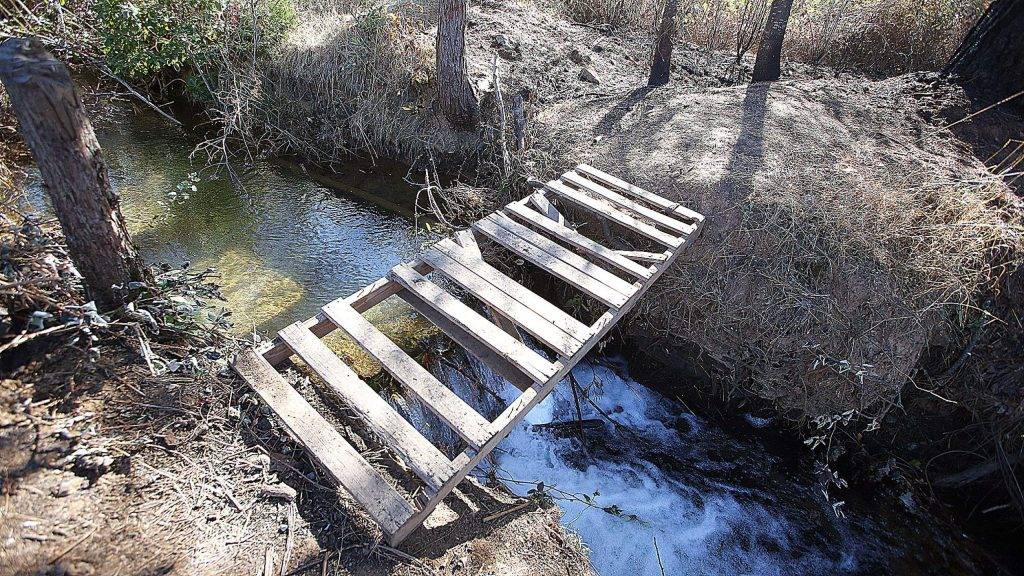 An intricate maze of trails and bridges were constructed by homeless people on the Loma Rica Ranch including these pallets once used as a bridge to access hidden encampments before the Dorsey Fire swept through Oct. 27.