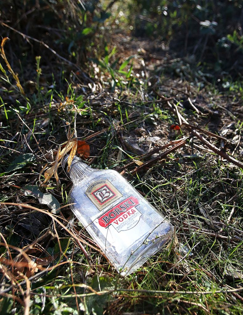 An alcohol bottle left on the Loma Rica Ranch property serves as a reminder that alcoholism is associated with many cases of chronic homelessness.