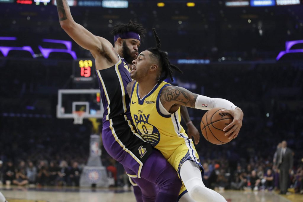 Golden State Warriors' D'Angelo Russell (0) is defended by Los Angeles Lakers' JaVale McGee during the first half of an NBA basketball game Wednesday.