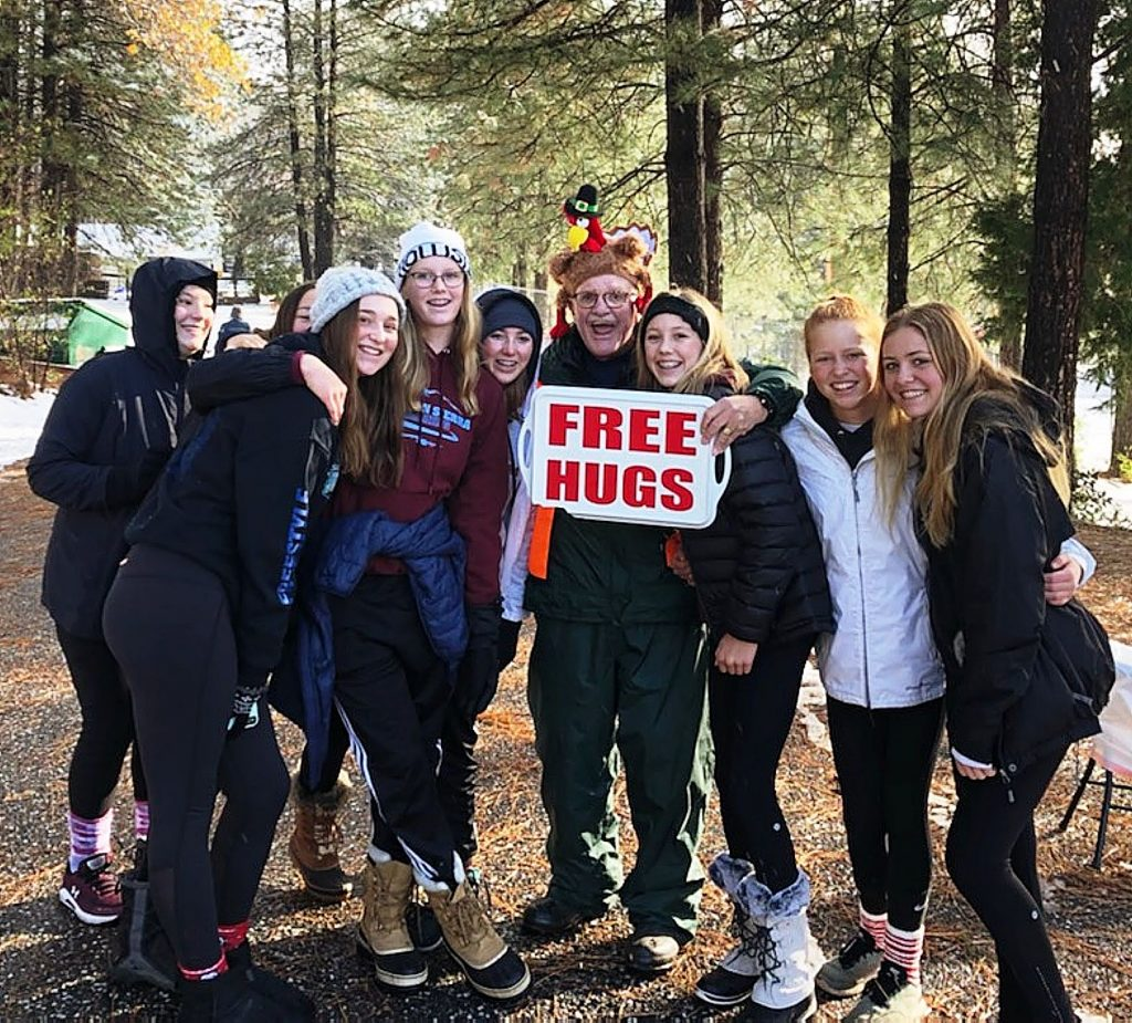 Civic leader Bill Drown dressed as a turkey and greeted runners and walkers with hugs at the annual MEB2 Turkey Trot on Thanksgiving Day.