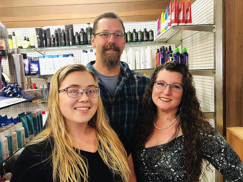 From left, Paige Bourget poses with her parents, Jamie and Theresa Bourget, who took ownership of Sam's Beauty Supply & Salon on November 1.