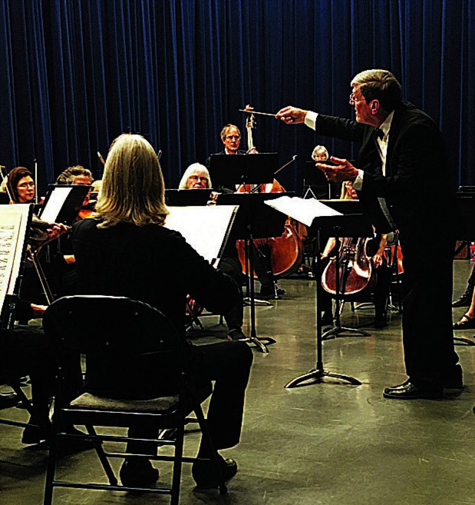 Steve Miller conducts OLLI Orchestra.