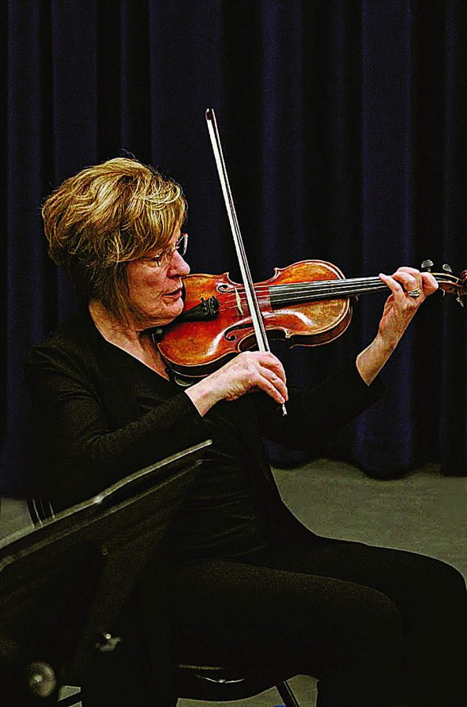 Laura Wagner-Balch playing violin.