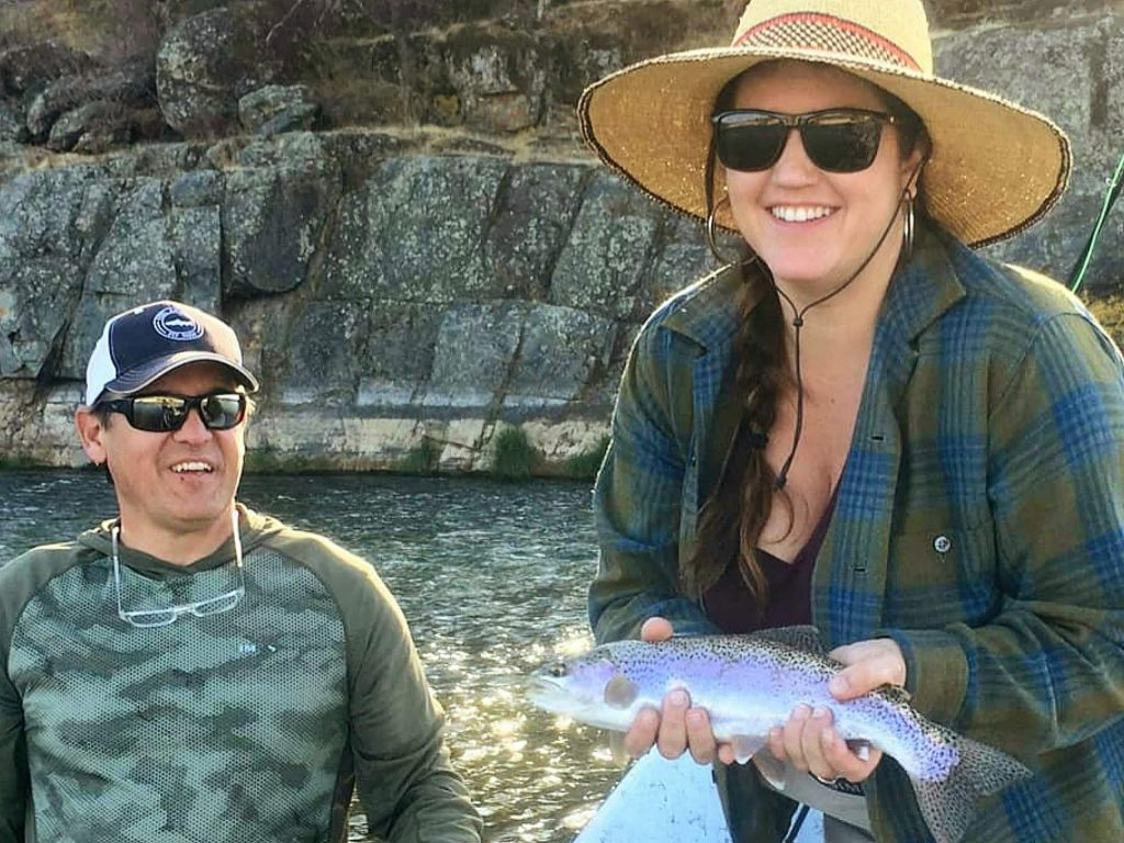 Lauren Garrison with a Yuba River steelhead caught with guide Tom Page.