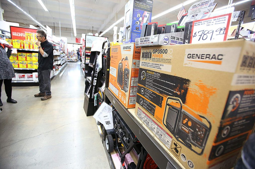 A shelf of Generac generators sit on the shelf while potential customers ask questions about them Tuesday afternoon at B&C Ace Home & Garden hardware store in Grass Valley's Glenbrook Basin.