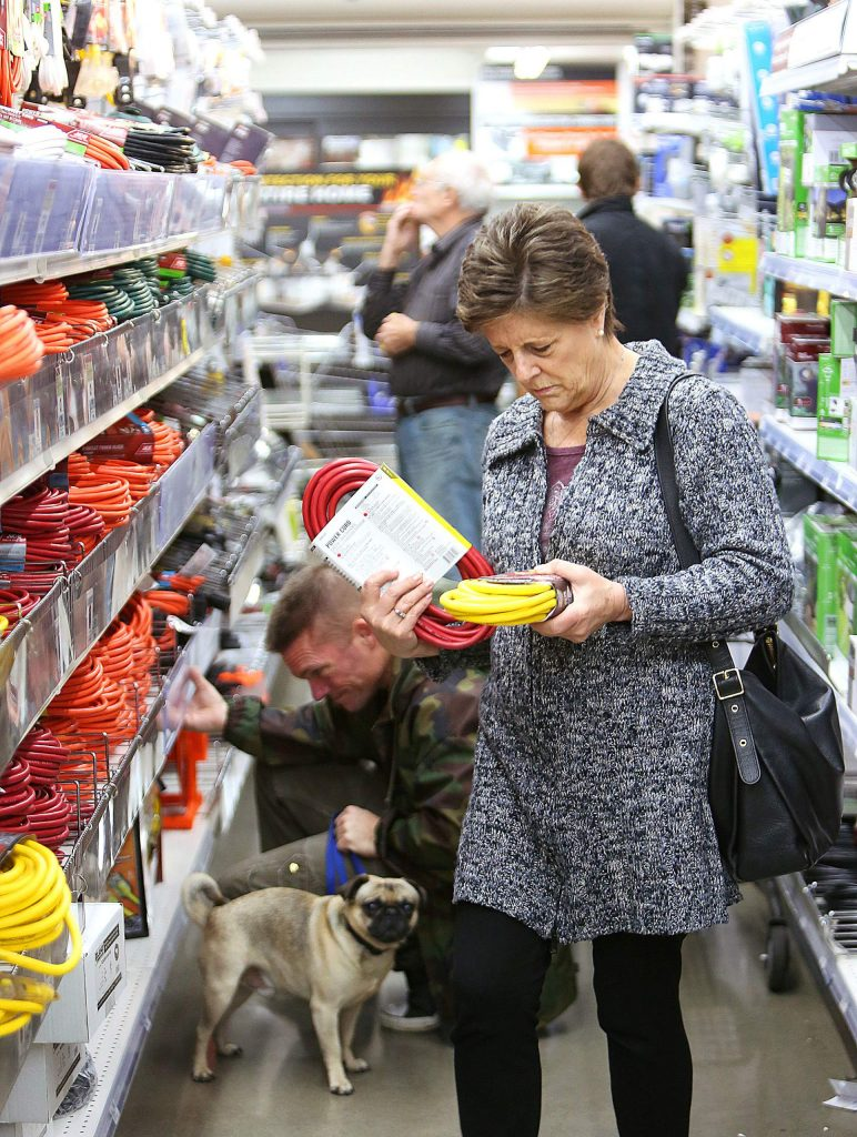 The aisles at B&C Ace hardware store in Grass Valley were full of shoppers buying extension cords, batteries, generators, kerosene, and other goods to help them through the planned PG&E power shutdown scheduled for Wednesday and Thursday.