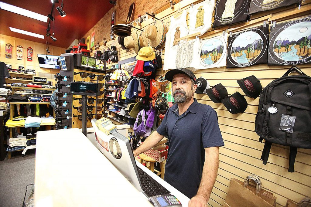 Goodtimes owner Sam Anderson stands behind the counter of his downtown Grass Valley skate and apparel store. Anderson said he's lost thousands of dollars in revenue due to the planned PG&E shutdowns, whether they happen or not.