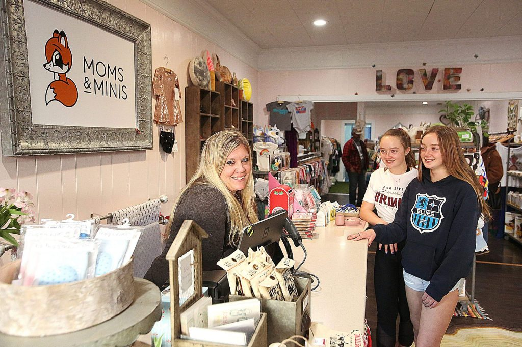 Moms & Minis manager Jaime Thibodeau stands behind the counter across from her mini's Mariah and Jade, whose school day at Bear River High School was cancelled due to the planned PG&E shutdown that never materialized in Nevada County.