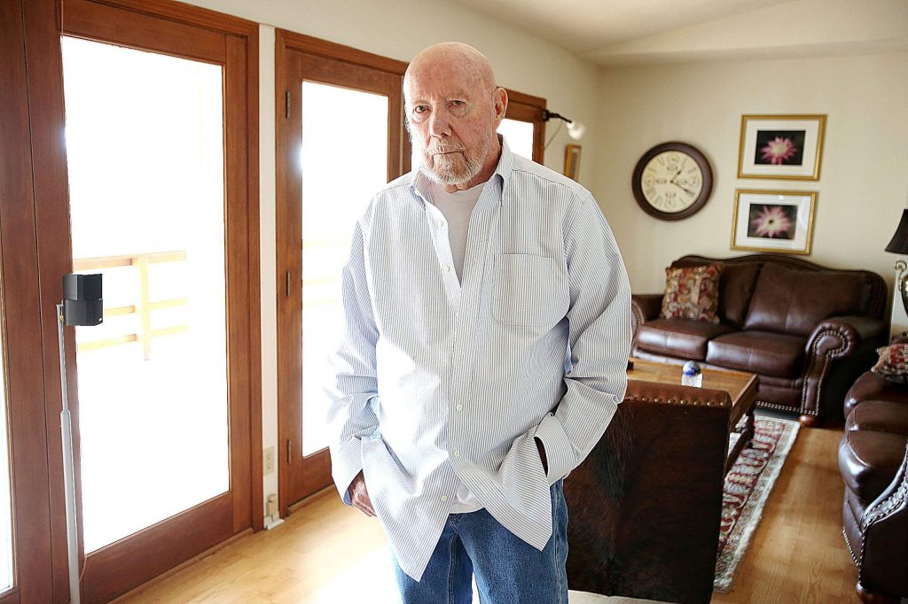 Alta Sierra's Jack Strickland is illuminated by available light that pours into his Forest Springs Mobile Home Park unit Tuesday afternoon much as it would when the power is expected to be turned off Wednesday. Strickland is one of hundreds of residents at the mobile home park who didn't receive shutdown notifications because he is on a master meter.