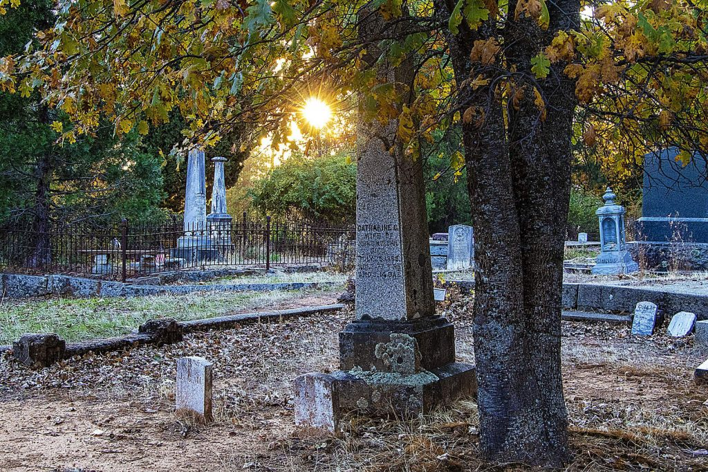 In honor of Day of the Dead, Folk Trails Hiking Club (Jesse Locks) & Inn Town Campground (Erin Theim) held an event/hike Friday, November 1 in downtown Nevada City. The group was visiting Pioneer Cemetery off of West Broad Street and Pine Grove Cemetery on Red Dog Road.