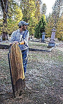 Matt Melugin from Nevada County Cemetery District discussing the last wooden grave marker in Pine Grove Cemetery Nevada City.