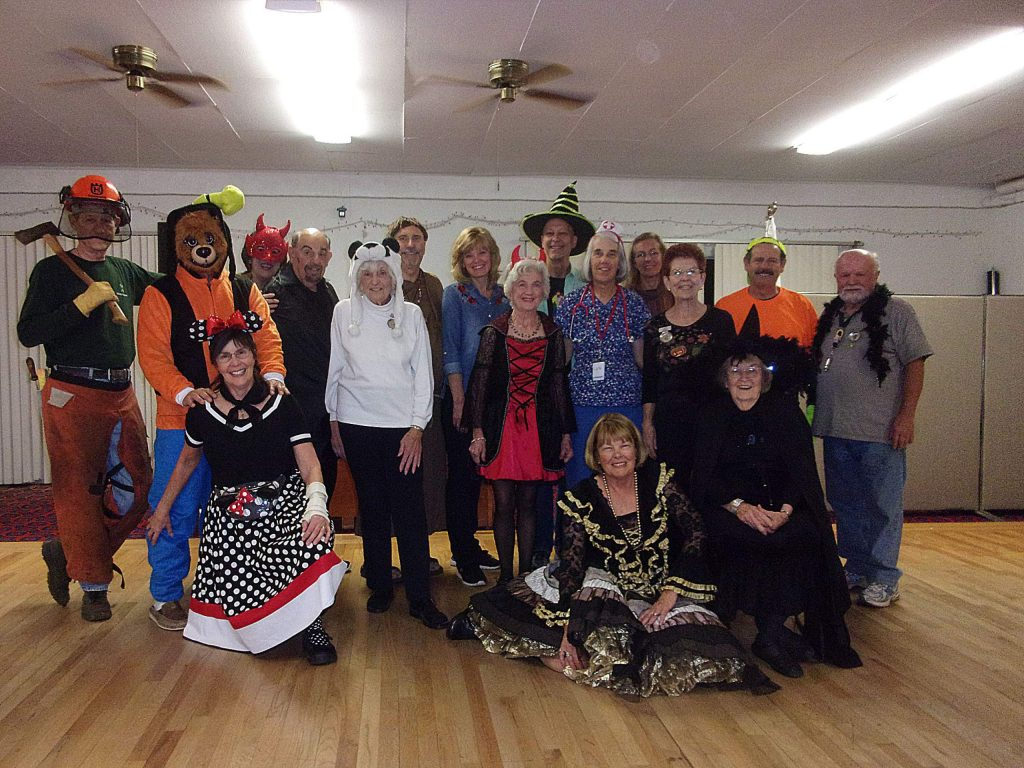 Goldancers Square Dance Club members celebrating Halloween.