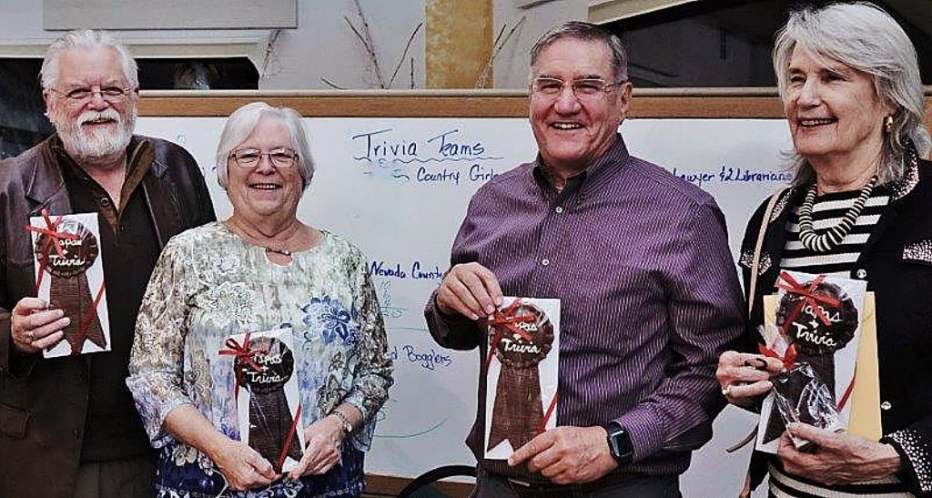 The winning Trivia Team with their chocolate trophies (from Lazy Dog), from left: Grass Valley Rotarians Rod Fivelstad, Judy Bagley, Scott Browne, and Connie Stone.