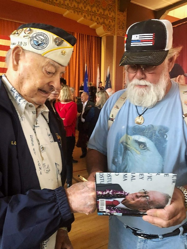 Lou Conter, one of the last survivors of the bombing of the USS Arizona, book signing for Ken Rose.