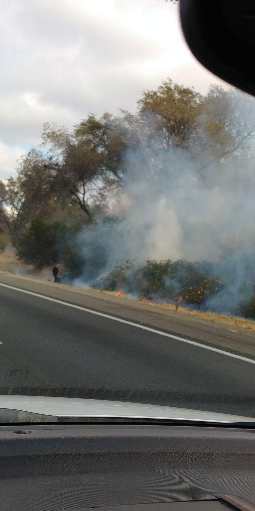 Spot fires burning along I-80 near Newcastle at 12:30 pm on November 19, 2019.