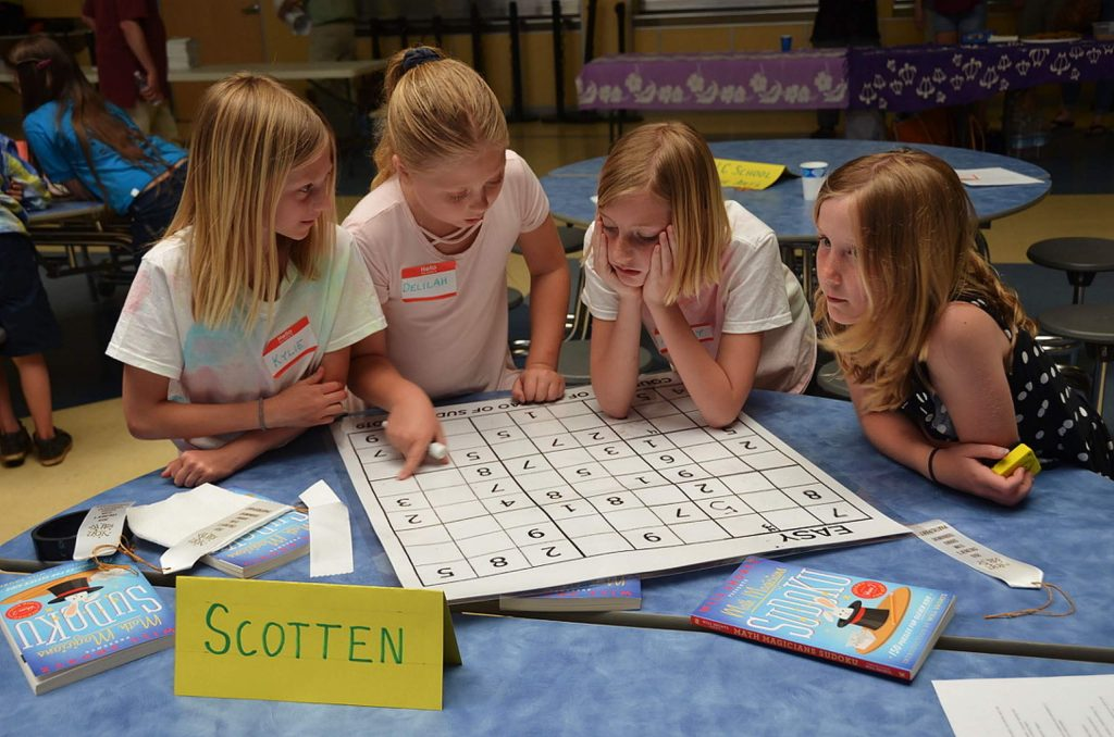 Third graders from Scotten Elementary School compete in the Third Annual Children's Team Sudoku Tournament. From left to right: Kylie Pryor, Delilah Gross, Avery Stone, Lily Cook