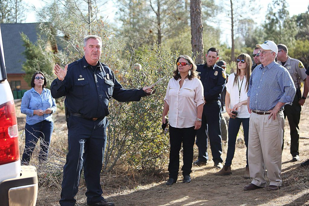 Cal Fire Division Chief Jim Mathias prompts the county officials on the Ponderosa West Grass Valley Defense Zone shaded fuel break.