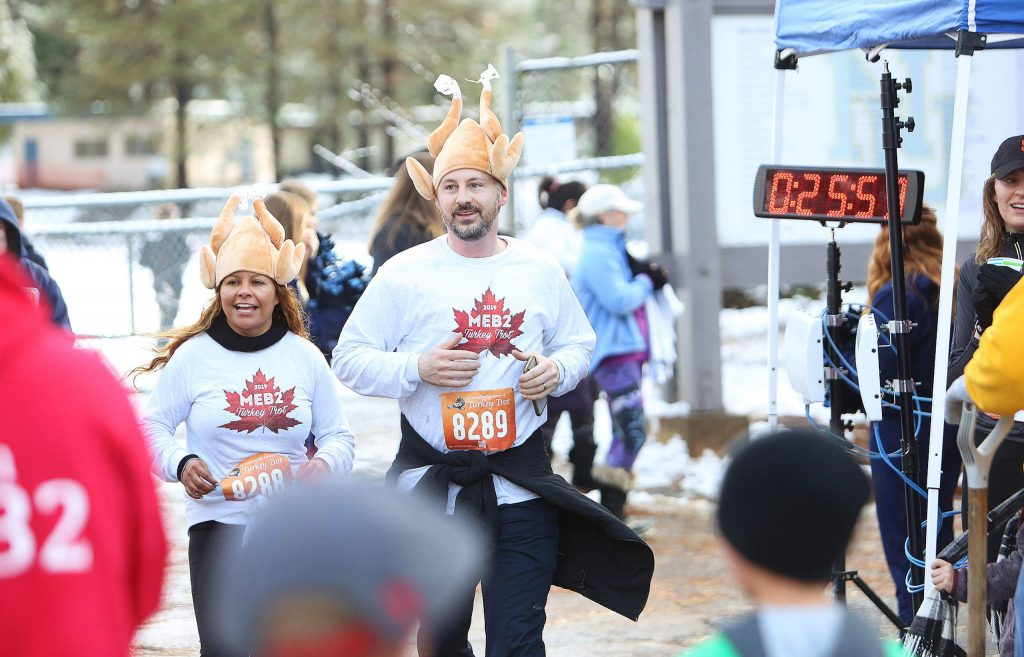 Janna and Grant Glaze cross the finish line Thursday at Nevada Union High School for the Michael E. Bratton II annual Turkey Trot.