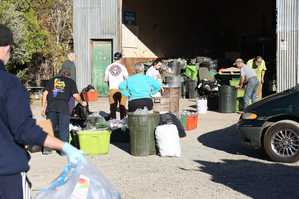 People line up to get their aluminum, glass, and plastic recycling in at Grass Valley Recycle off Idaho Maryland Road. The business is slated to close for good at 4 p.m. Friday.