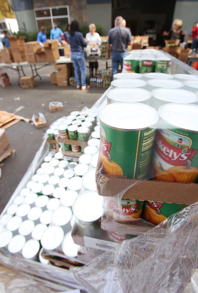 Pallets of canned and non-perishable foods were sorted and filled into holiday food bags Tuesday at the Food Bank of Nevada County.