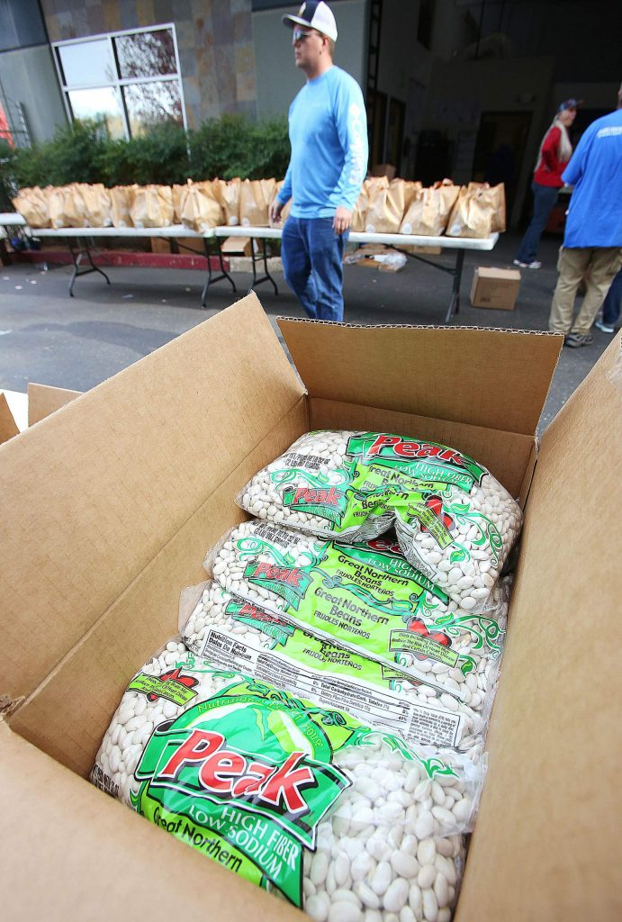 Many different items including a bag of Great Northern Beans were included in the Food Bank of Nevada County's holiday food bags that will be distributed to area families on Thursday.
