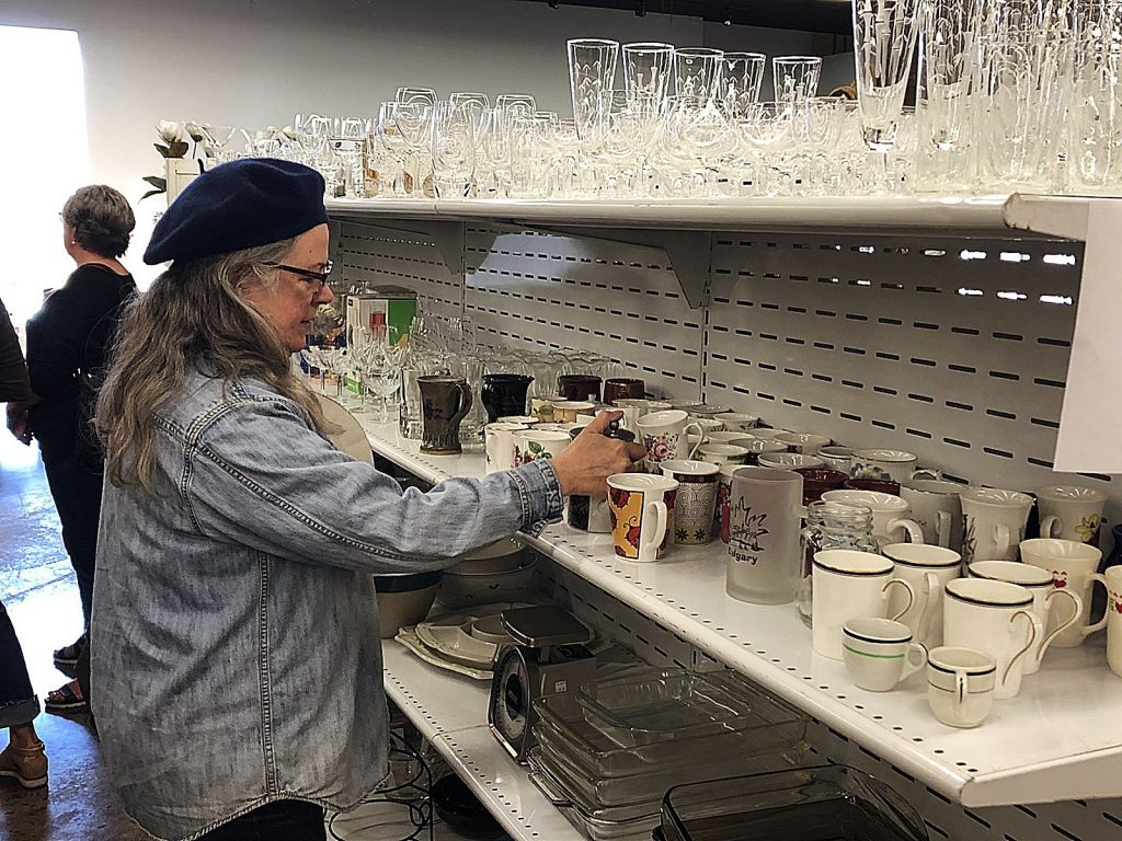 Cynthia Ott is roaming through Sammie's Nifty Thrift Shop. An Oakland resident, Ott enjoys supporting the store and rummaging for good deals.