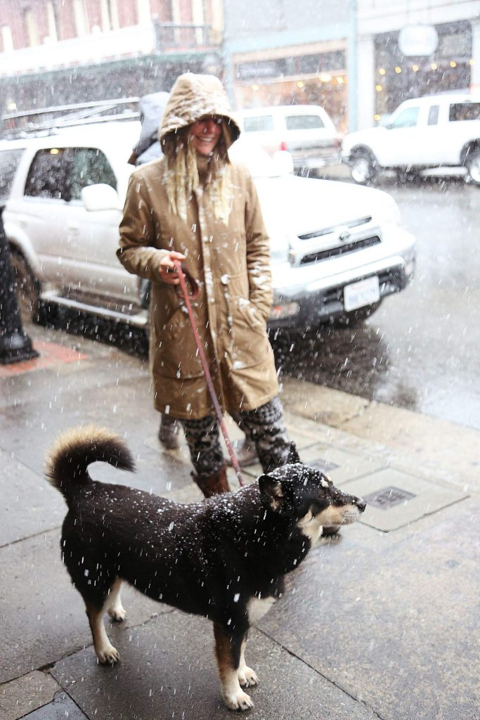 Hannah Lipski and her dog Roxie don't mind the Nevada City snowfall Tuesday afternoon along Broad Street.