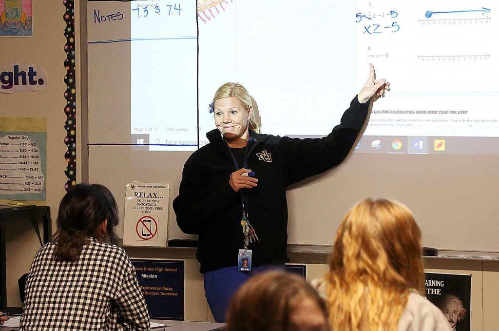 Basic Algebra teacher Beth Kesler goes over the day's lesson to a class full of students Wednesday at the NUHS campus.