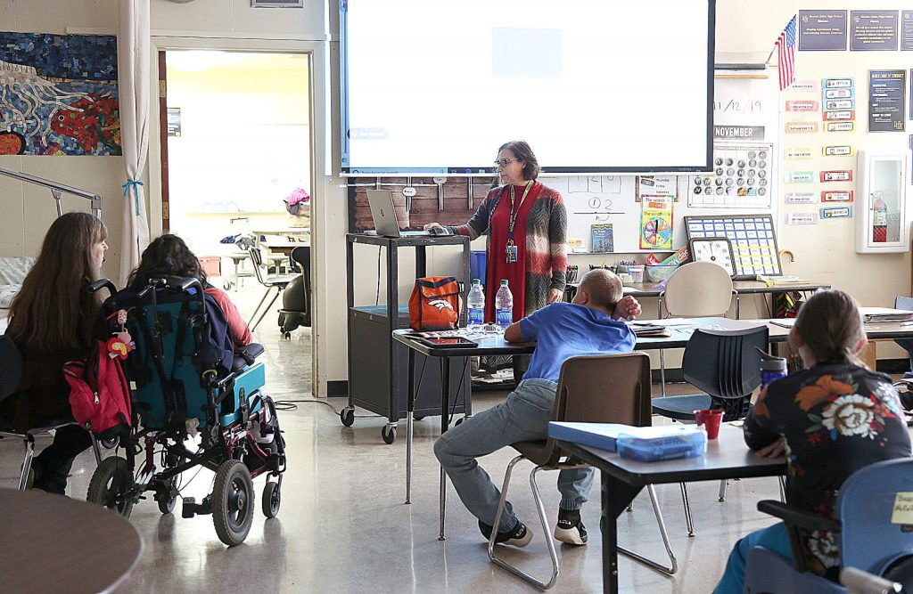 Nevada Union High School's Jenni Mullins gives instruction to a group of students in the school's moderate to severe special education class Wednesday on campus.