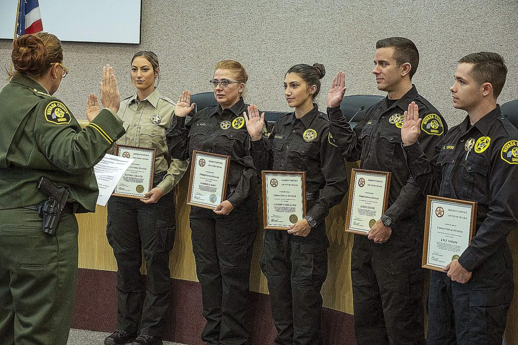 Nevada County Sheriff Shannan Moon, left, swearing in the new employees.