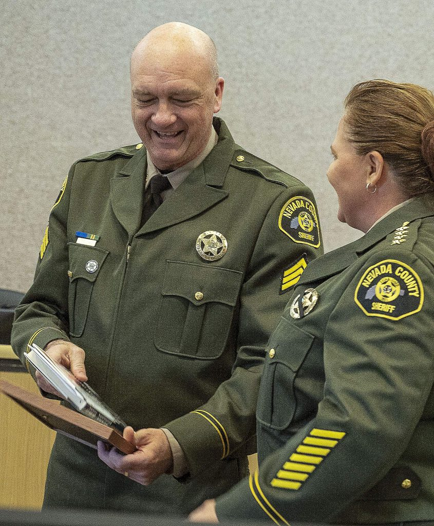 New sheriff's Sgt. Steve Stanley, left, and Sheriff Shannan Moon.