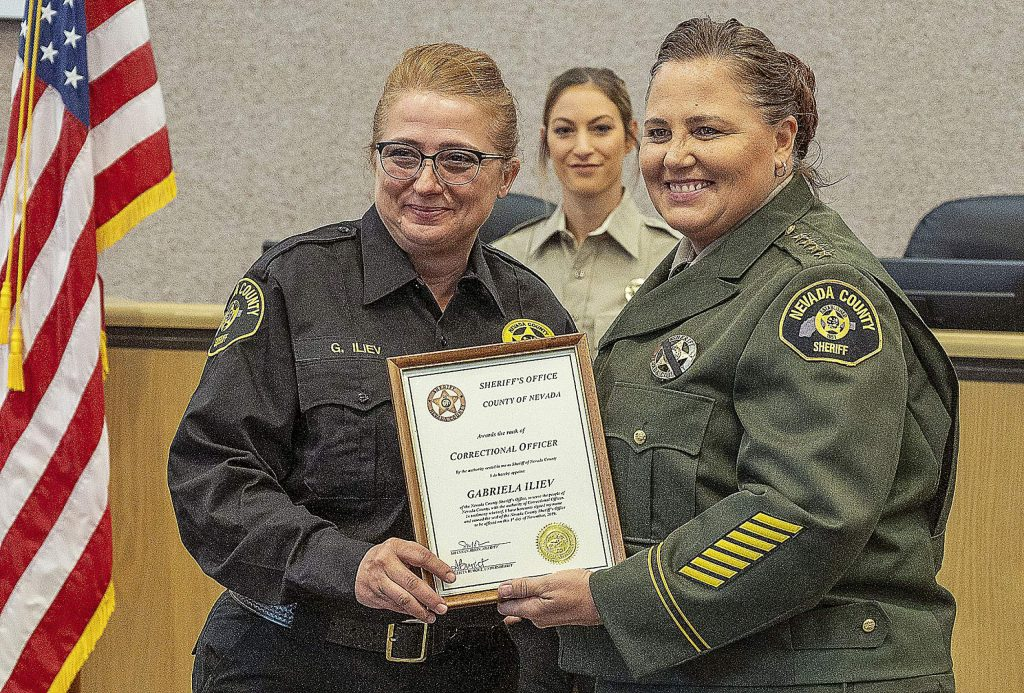 New Correctional Officer I Gabriela Iliev, left, and Sheriff Shannan Moon.