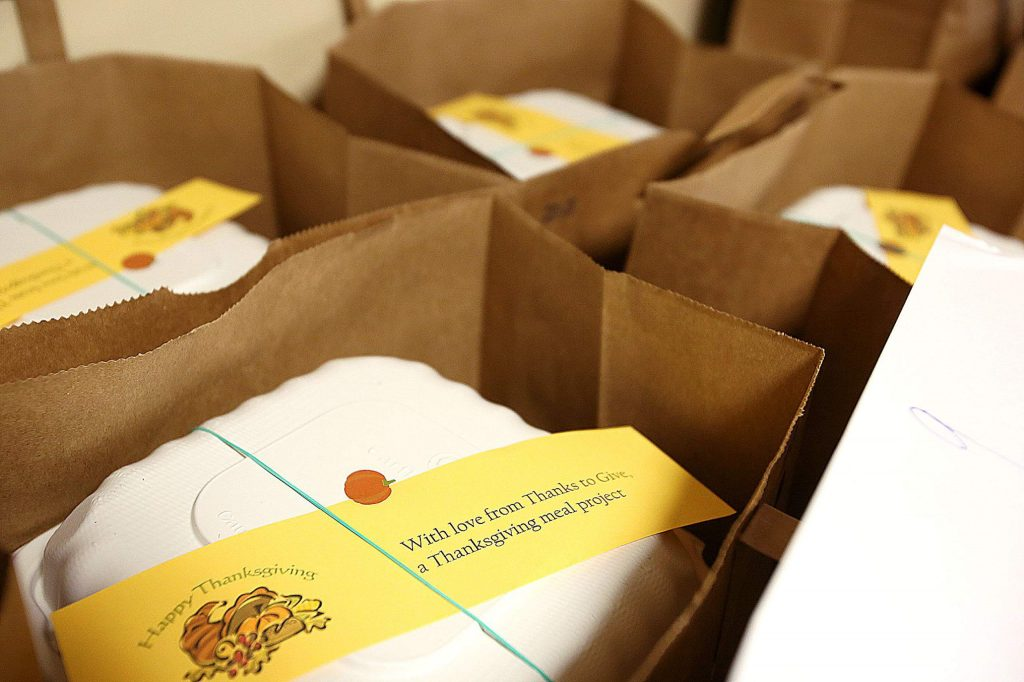 The Thanks to Give Thanksgiving meals come with a special message, holiday cards, and bouquets of flowers along with the turkey dinner.
