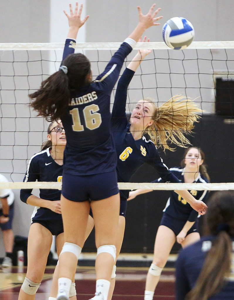 Nevada Union sophomore Kayda Kinch (6) finds the gap and puts the ball over the net away from a Central Catholic defender during Saturday's volleyball championship game loss to the Raiders.