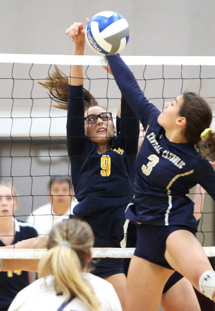 Nevada Union's Kailee McLaughlin (9) blocks a Raiders spike Saturday at Natomas High.