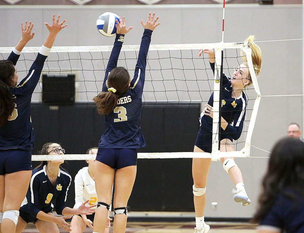 Nevada Union sophomore Kayda Kinch (6) spikes the ball during Saturday's volleyball championship game loss to the Raiders.