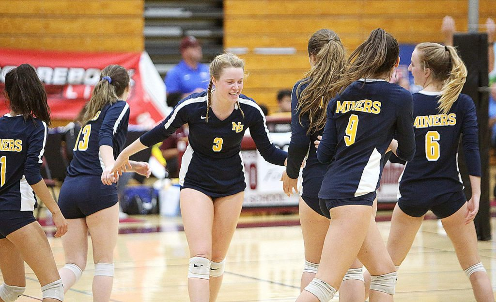 Nevada Union's Faith Menary (3) congratulates her team mates following a point against the Central Catholic Raiders.