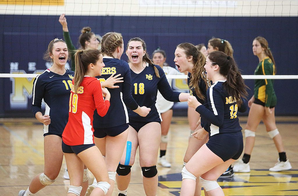 The Miners girls volleyball team celebrates a hard fought point as they get closer to winning the D 3 section semi-final against the Hilmar Yellowjackets in 5 sets.