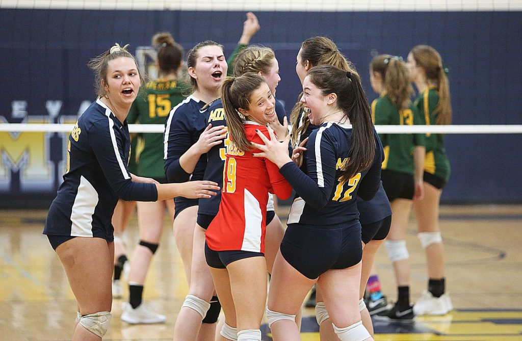 The Lady Miners erupt into a fit of jubilation as they get within a few points of winning a set against the Yellowjackets Tuesday night.